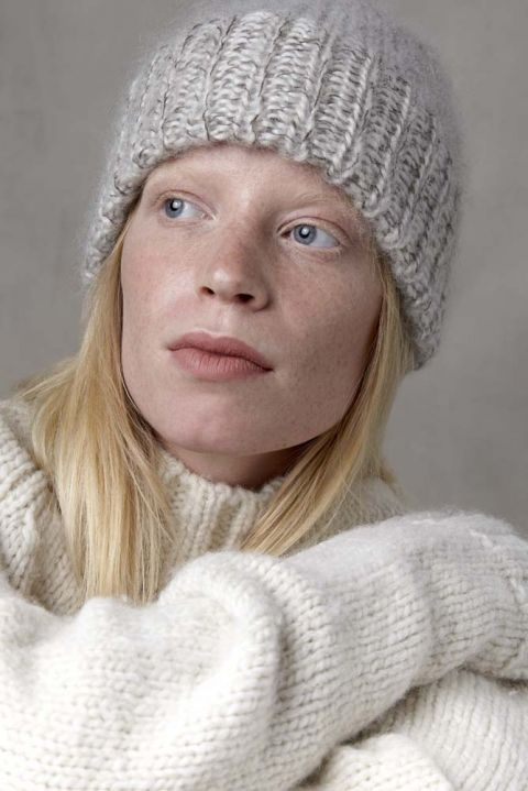 Dutch alpaca wool beanie with model.