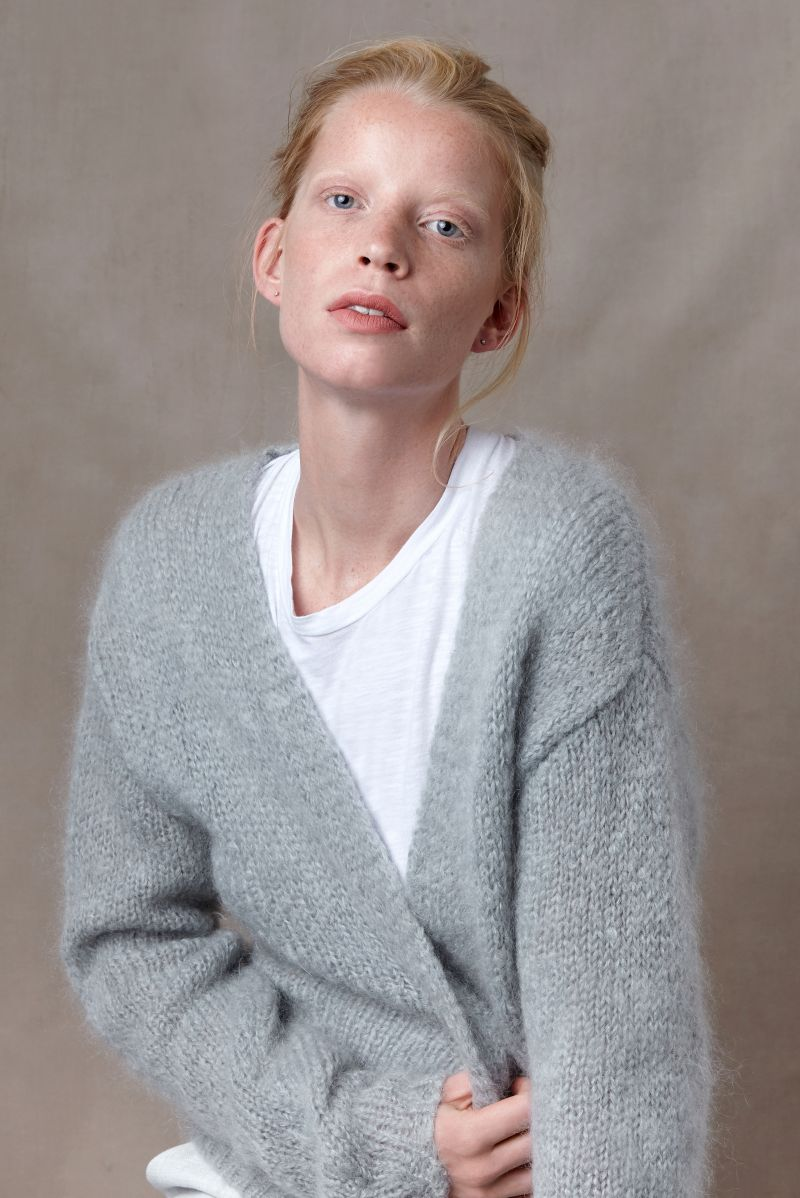 Babs short ladies cardigan made of mohair wool with model.