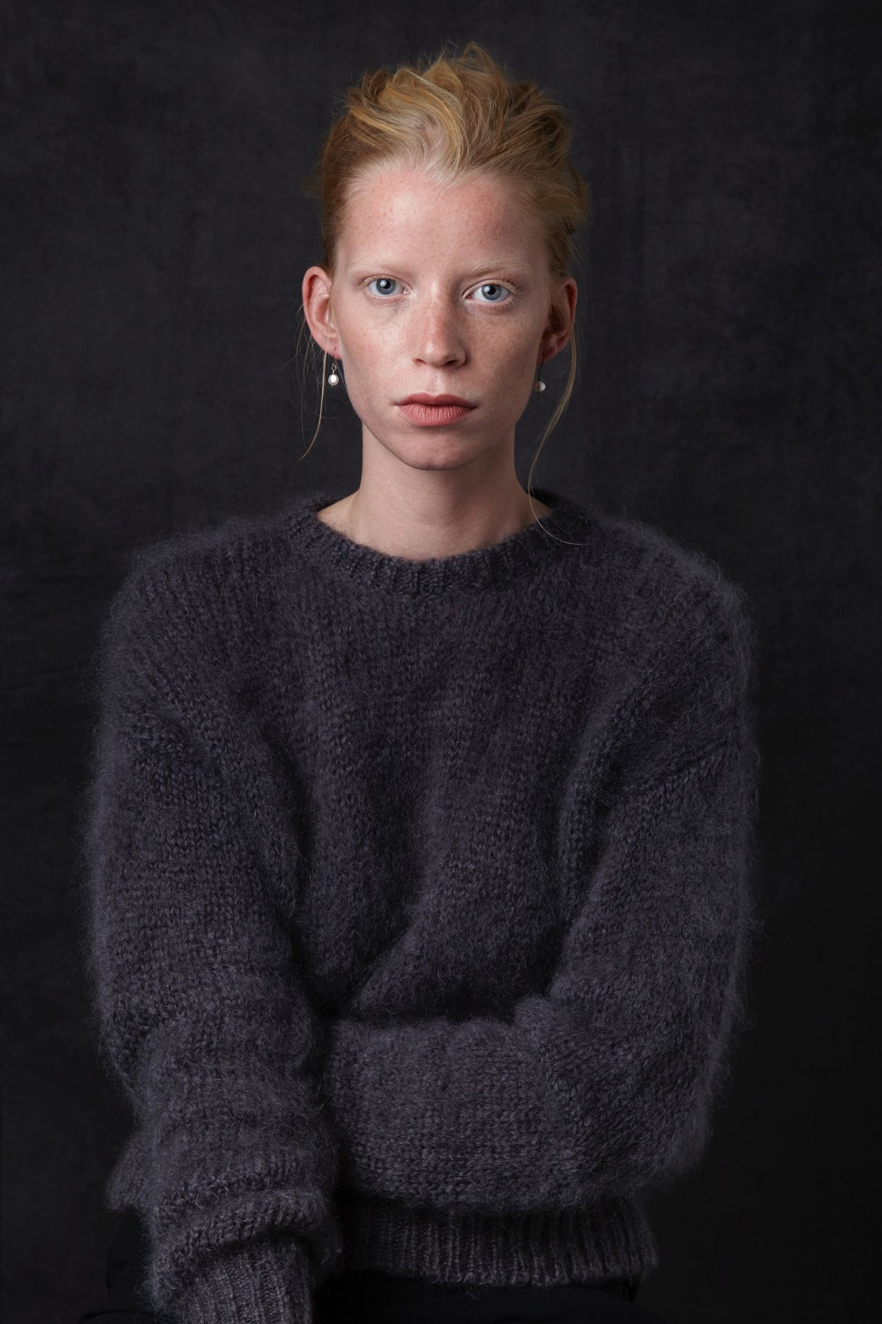 Daan mohair wool sweater from Dutch goats with model.