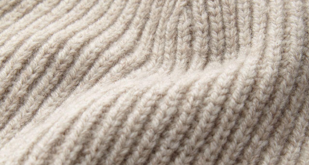 Merino sand detail breisel.