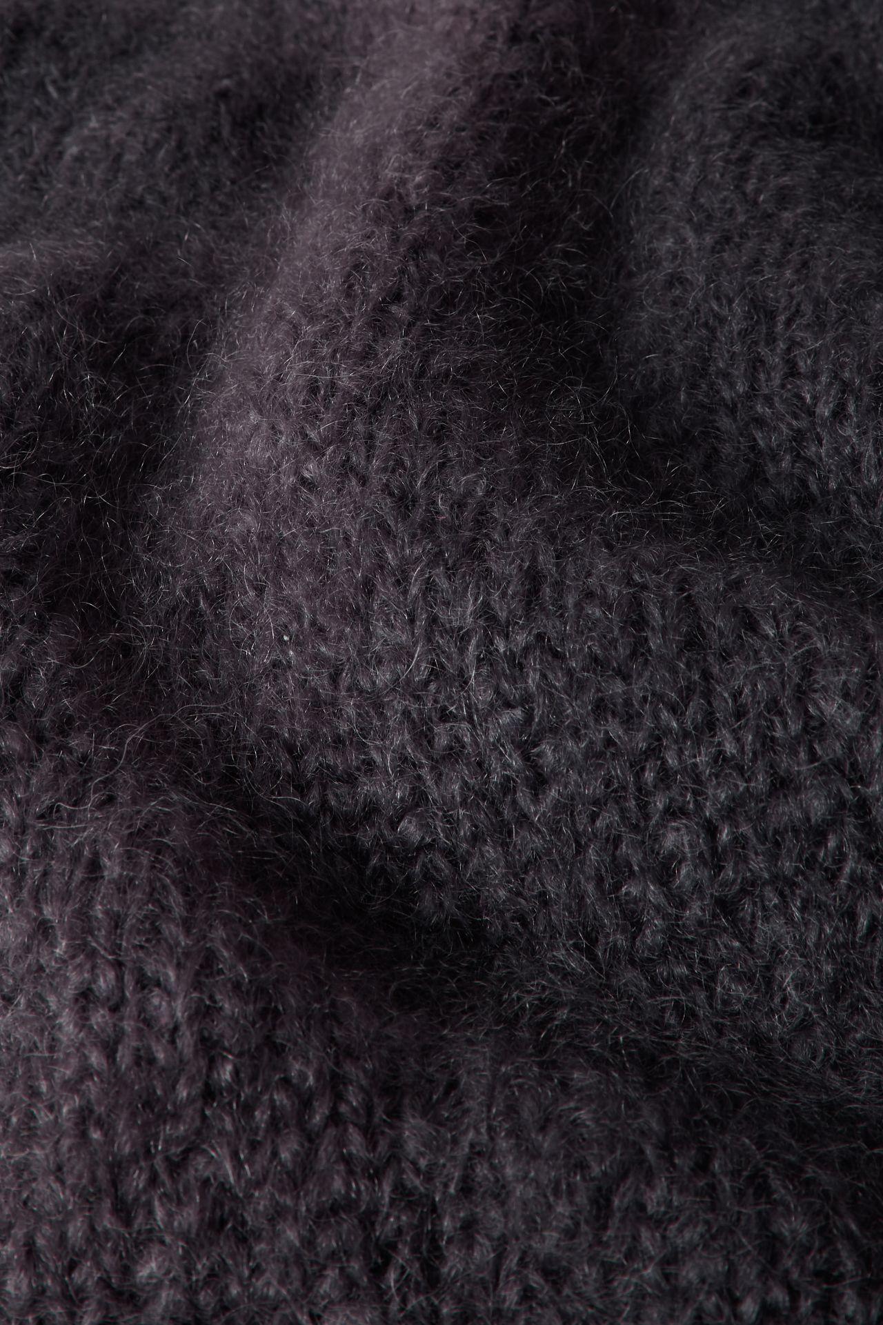 Mohair yarn dark grey knit detail.
