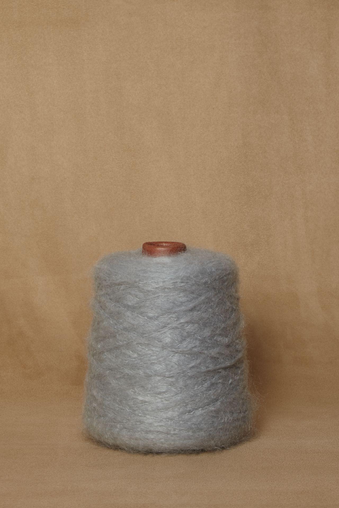 Mohair light blue yarn packshot.